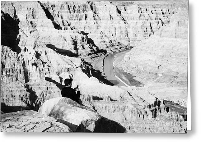 Guano Greeting Cards - Teenage Boy Standing Looking Into The Grand Canyon Taking Photos With Smart Phone River Guano Point  Greeting Card by Joe Fox