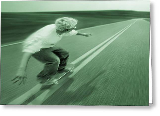 Young Teen Greeting Cards - Teenager Skateboarding Down Road Greeting Card by Don Hammond