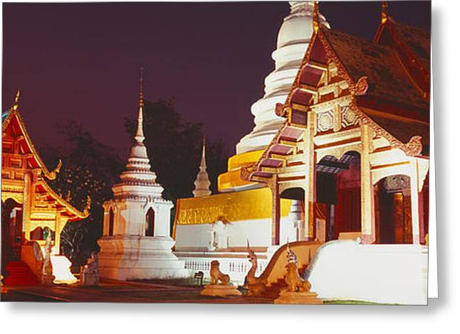 Chiang Mai Greeting Cards - Temple Lit Up At Night, Wat Phra Singh Greeting Card by Panoramic Images