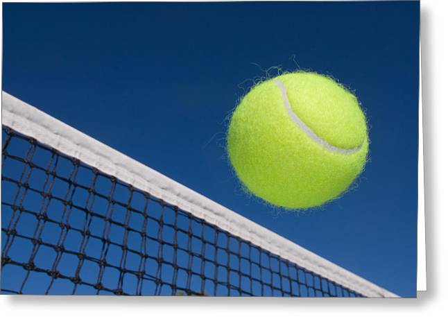 Forehand Greeting Cards - Tennis ball and net Greeting Card by Joe Belanger