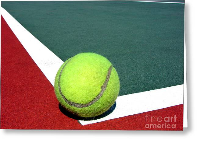 Tennis Club Greeting Cards - Tennis Ball on Court Greeting Card by Olivier Le Queinec