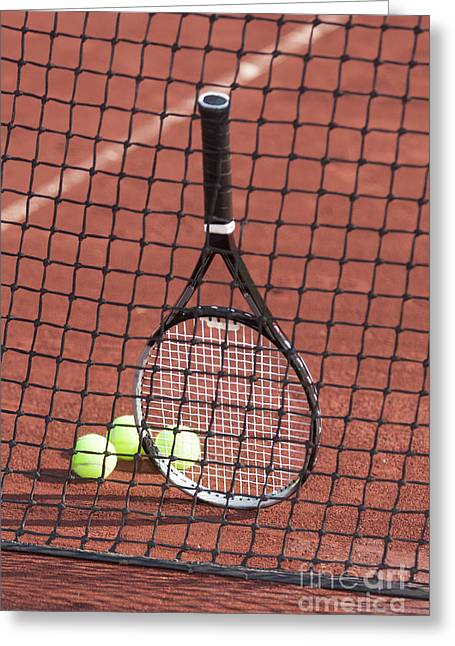 Tennis; Racquet; Ball; Balls; Shadow; Game; Games; Sport; Sports; Shadow; Tennis Ball; Tennis Racquet; Competition Greeting Cards - Tennis racket and balls against a net. Greeting Card by Don Landwehrle