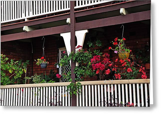Red Geraniums Greeting Cards - Terrace House with Flowers 2 Greeting Card by Kaye Menner