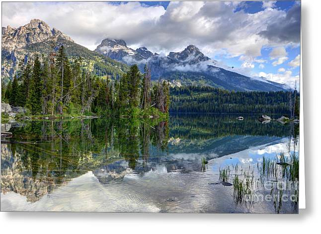 Nez Perce Greeting Cards - Teton Mountains Reflected in Taggart Lake Greeting Card by Gary Whitton