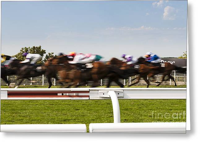 Goodwood Greeting Cards - The blur of racehorses racing by the rails on a race track  Greeting Card by Peter Noyce