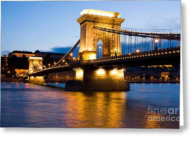 The Chain Bridge in Budapest lit by the street lights Greeting Card by Kiril Stanchev