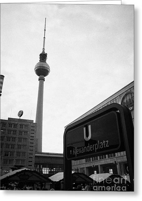 U-bahn Photographs Greeting Cards - the christmas market in Alexanderplatz with the Berlin Fernsehturm and U-bahn sign Germany Greeting Card by Joe Fox