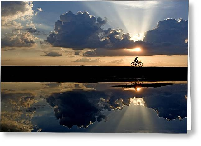 Reflections Of Sky In Water Greeting Cards - The Cyclist Greeting Card by Partha Pal