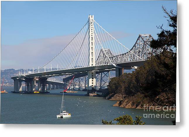 Yerba Beuna Island Greeting Cards - The New And The Old Bay Bridge San Francisco Oakland California 5D25405 Greeting Card by Wingsdomain Art and Photography