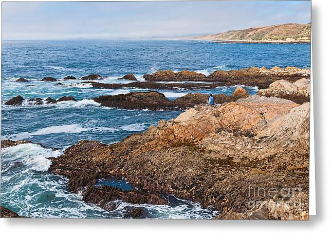 Montana De Oro Greeting Cards - The Observer - Jagged rocks and cliffs of Montana de Oro State Park in California with man sitting Greeting Card by Jamie Pham