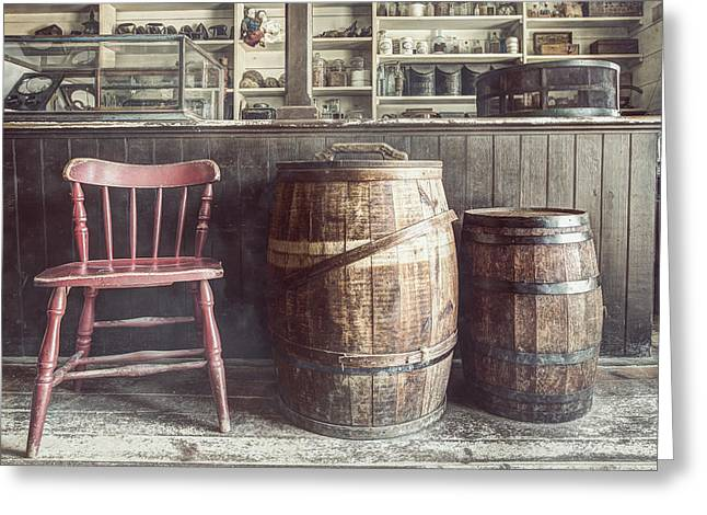 Old Stuff Greeting Cards - The Old General Store - Red chair and Barrels in this 19th Century Store Greeting Card by Gary Heller