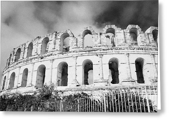 African Heritage Greeting Cards - The Old Roman Colloseum Against Blue Cloudy Sky El Jem Tunisia Greeting Card by Joe Fox