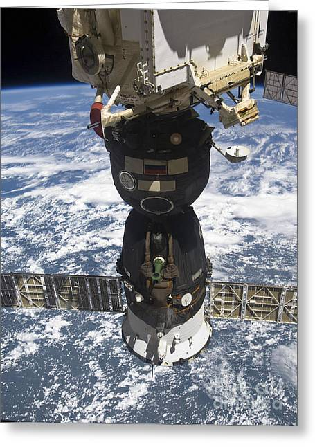 Travel Agency Greeting Cards - The Soyuz Tma-19 Spacecraft Docked Greeting Card by Stocktrek Images