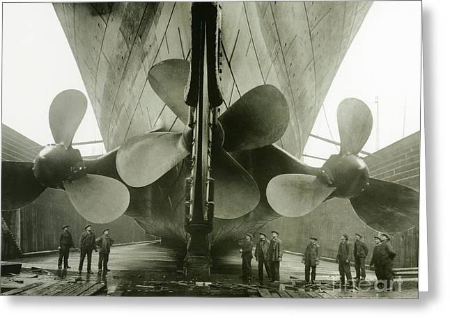 Propeller Photographs Greeting Cards - The Titanics propellers in the Thompson Graving Dock of Harland and Wolff Greeting Card by English Photographer