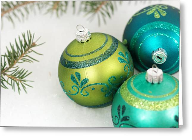 Christs Birthday Greeting Cards - Three Christmas Ornaments in the Snow Greeting Card by Carolyn Rauh