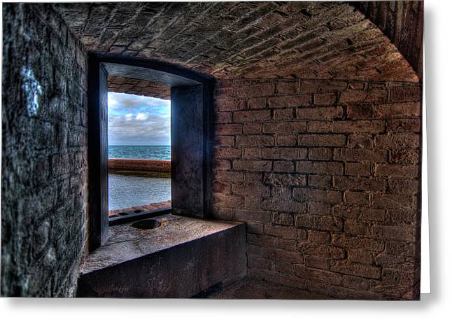 Through The Fort Window Greeting Card by Andres Leon