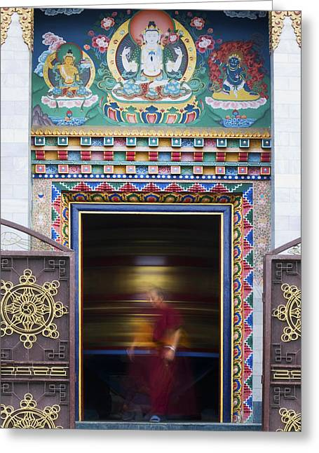 Enlightenment Photographs Greeting Cards - Tibetan Monk and the Prayer Wheel Greeting Card by Tim Gainey