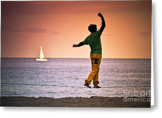 Walking Tightrope Greeting Cards - Tightrope walking man at beach. Greeting Card by Marc SOLER MARCE