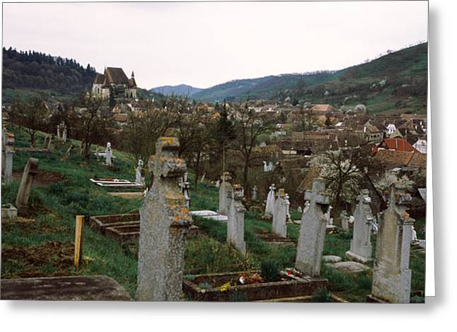 Romania Photographs Greeting Cards - Tombstones In A Cemetery, Saxon Church Greeting Card by Panoramic Images
