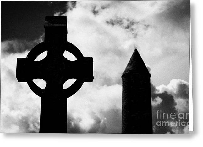 Significance Greeting Cards - top of St Kevins Round Tower and celtic cross headstone at Glendalough monastic site county wicklow ireland Greeting Card by Joe Fox