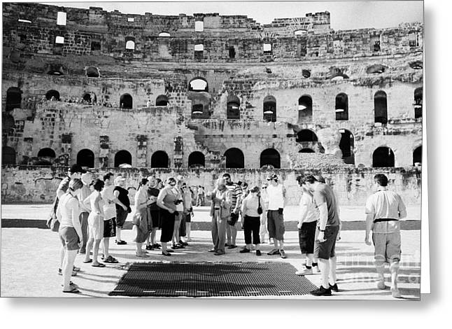 African Heritage Greeting Cards - Tour Guide Explains To Group Of British Tourists About Gladiator Pits On The Floor Of The Arena Of The Old Roman Colloseum At El Jem Tunisia Greeting Card by Joe Fox