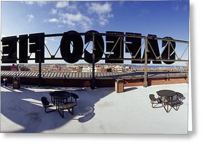 Baseball Stadiums Greeting Cards - Tourist Sitting On A Roof Greeting Card by Panoramic Images