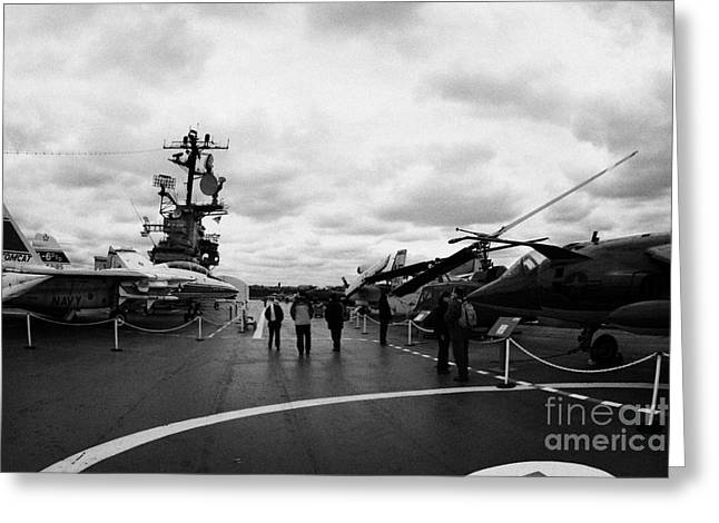 Manhatan Greeting Cards - tourists and Aircraft on the flight deck of the USS Intrepid new york city Greeting Card by Joe Fox