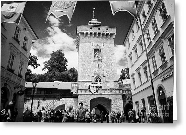Polish City Greeting Cards - tourists and visitors at the Florianska Gate old city entrance to krakow Greeting Card by Joe Fox