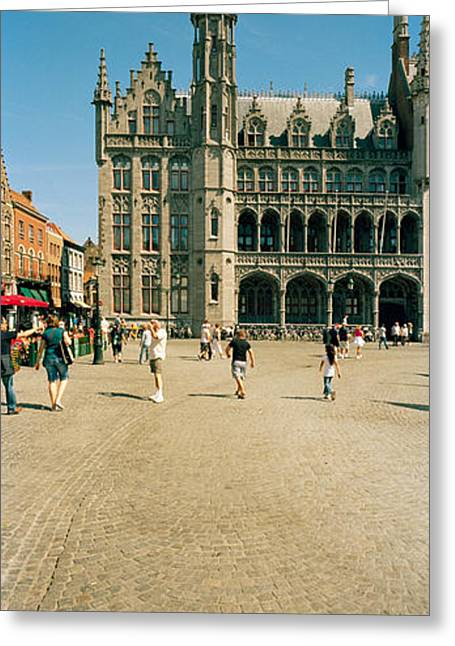 Town Square Greeting Cards - Tourists At A Market, Bruges, West Greeting Card by Panoramic Images