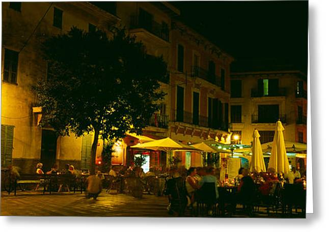 Night Cafe Photographs Greeting Cards - Tourists At A Sidewalk Cafe, Majorca Greeting Card by Panoramic Images