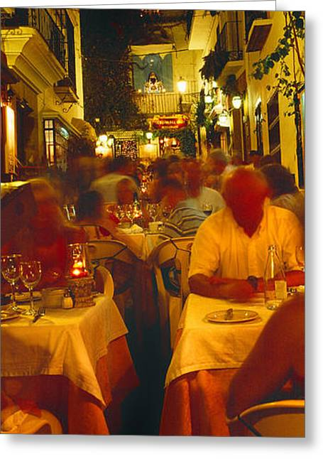 Night Cafe Photographs Greeting Cards - Tourists At A Sidewalk Cafe, Marbella Greeting Card by Panoramic Images