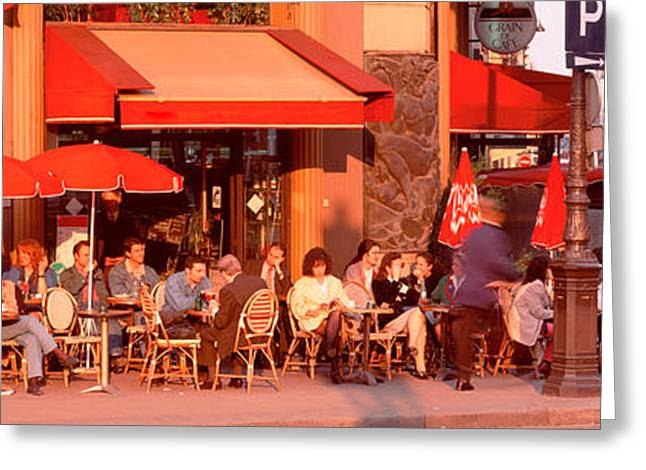 Corner Cafe Greeting Cards - Tourists At A Sidewalk Cafe, Paris Greeting Card by Panoramic Images