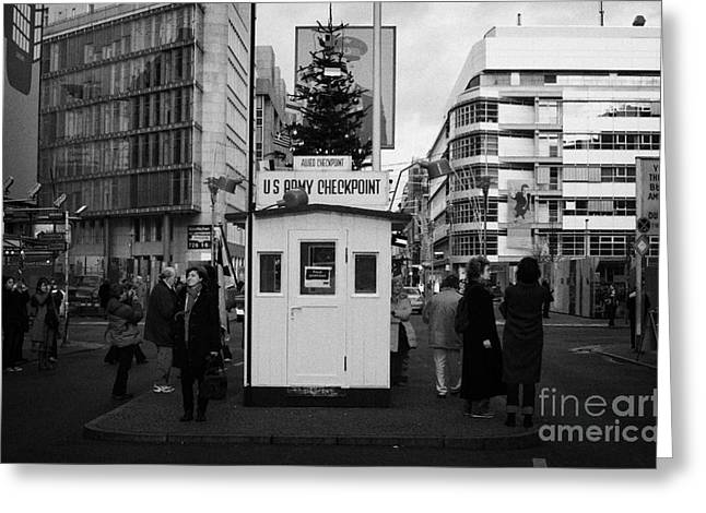 Berlin Germany Greeting Cards - tourists at checkpoint charlie ersatz cabin reconstruction in the middle of Friedrichstrasse Berlin Greeting Card by Joe Fox