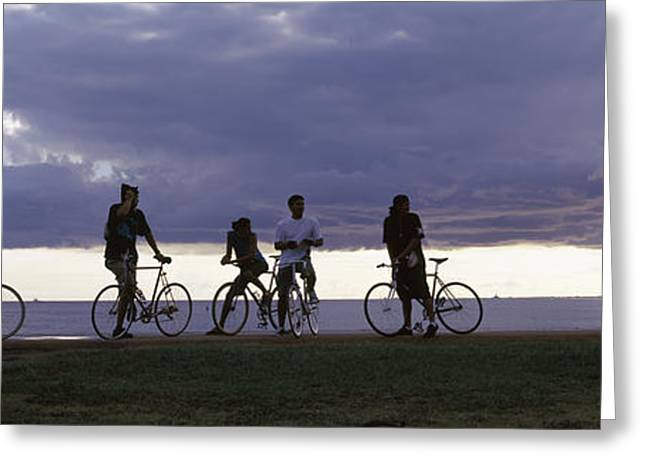 On The Beach Greeting Cards - Tourists Cycling On The Beach Greeting Card by Panoramic Images