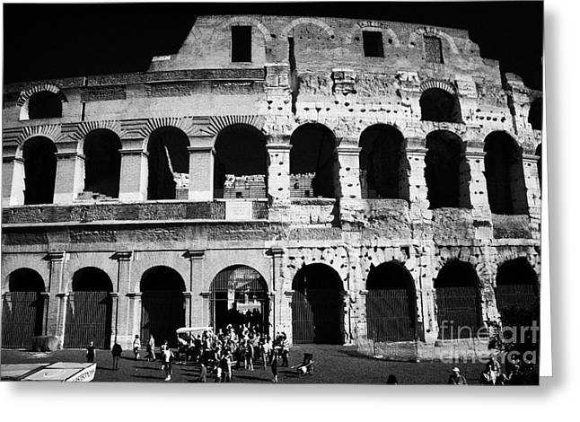 Tourists exit the rear entrance to the colosseum Rome Lazio Italy Greeting Card by Joe Fox