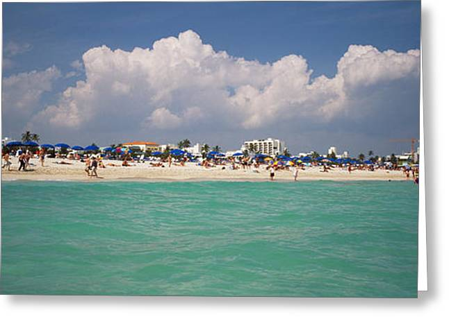 Blue Umbrella Greeting Cards - Tourists On The Beach, Miami, Florida Greeting Card by Panoramic Images