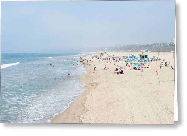 California Beach Greeting Cards - Tourists On The Beach, Santa Monica Greeting Card by Panoramic Images