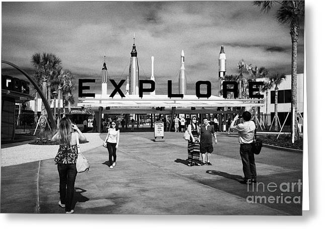 Kennedy Space Center Greeting Cards - tourists pose for photos outside the entrance to the Kennedy Space Center Florida USA Greeting Card by Joe Fox