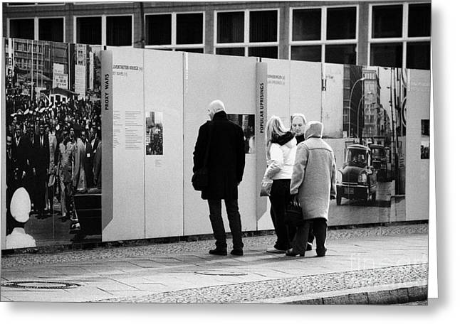 Checkpoint Greeting Cards - tourists read the history of the berlin wall at checkpoint charlie Berlin Germany Greeting Card by Joe Fox