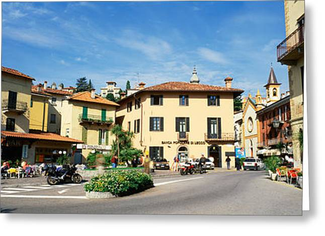 Town Square Greeting Cards - Tourists Sitting At An Outdoor Cafe Greeting Card by Panoramic Images