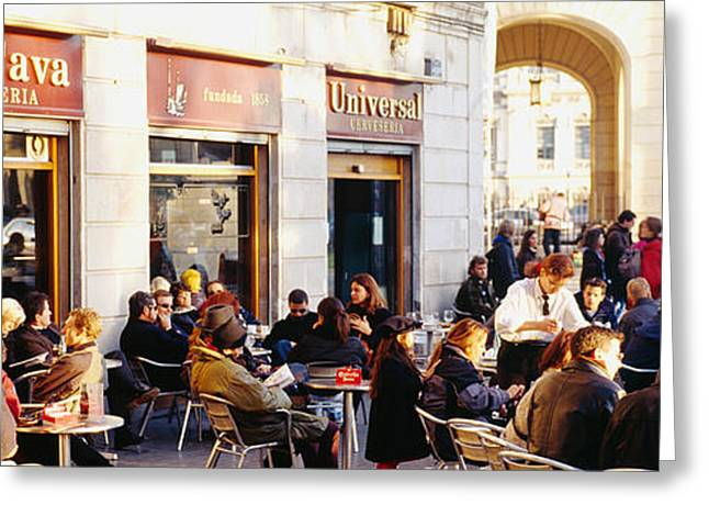 Script Greeting Cards - Tourists Sitting Outside Of A Cafe Greeting Card by Panoramic Images