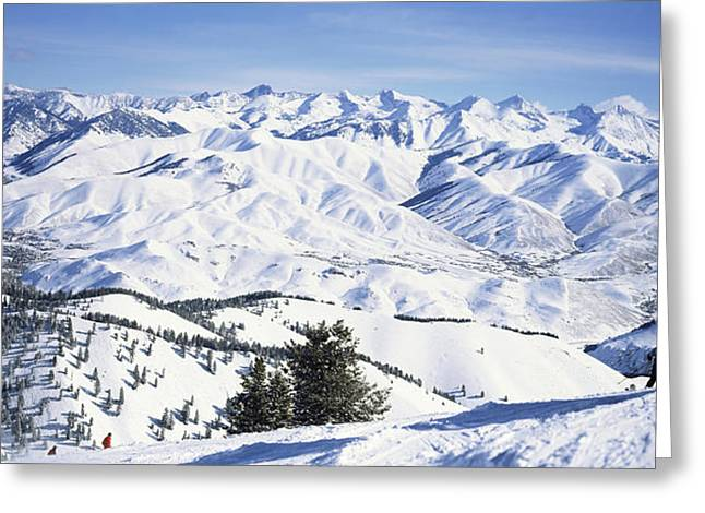 Tourists Skiing In Snow Covered Greeting Card by Panoramic Images