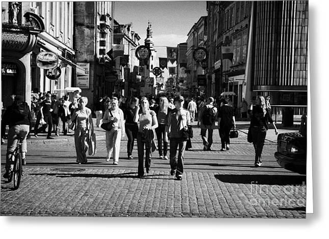 Polish City Greeting Cards - tourists walking along Grodzka street towards camera and towards main town square in Krakow Greeting Card by Joe Fox