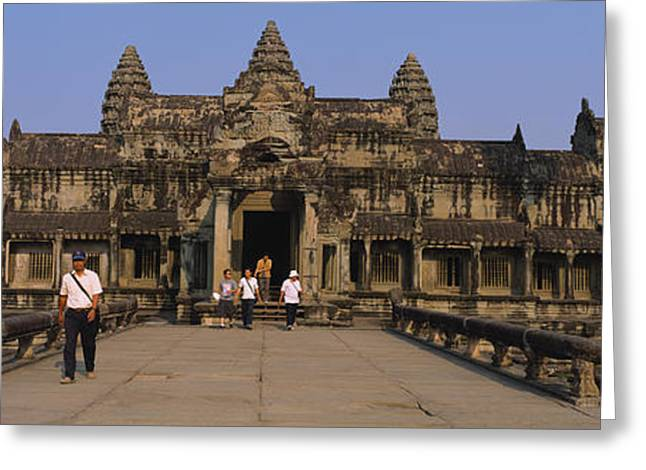 Siem Reap Greeting Cards - Tourists Walking In Front Of An Old Greeting Card by Panoramic Images