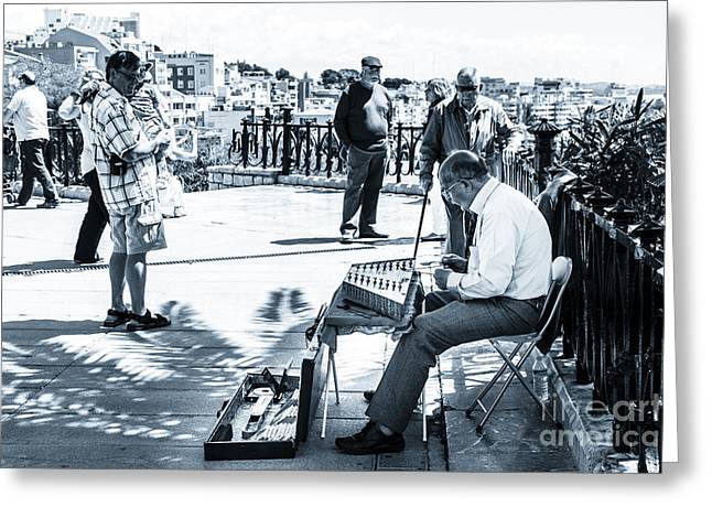 Playing Musical Instruments Greeting Cards - tourists watching busker playing santoor dulcimer at Tarragona S Greeting Card by Peter Noyce