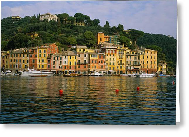 Reflections Of Sky In Water Greeting Cards - Town At The Waterfront, Portofino, Italy Greeting Card by Panoramic Images