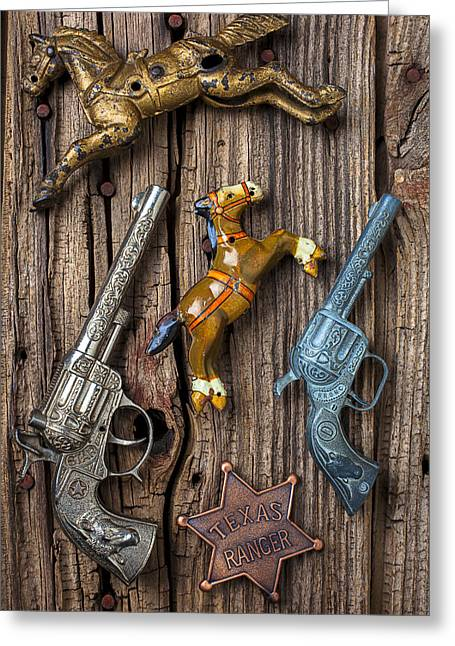 Rusty Nail Greeting Cards - Toy guns and horses Greeting Card by Garry Gay