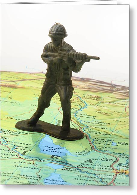 Iraq Conflict Greeting Cards - Toy Solider on Iraq Map Greeting Card by Amy Cicconi
