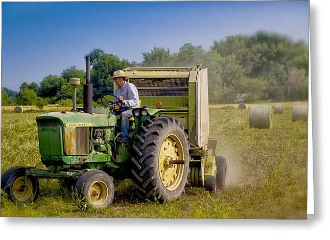 Bailing Hay Greeting Cards - Tractor Man Greeting Card by Michael Huddleston