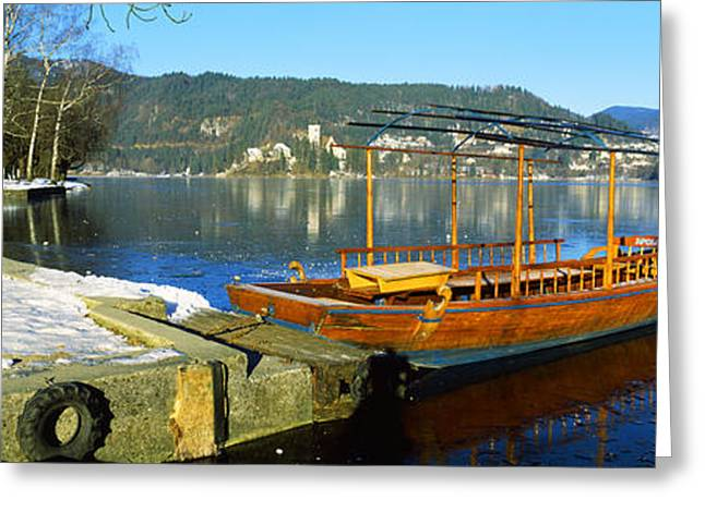Bled Greeting Cards - Traditional Boat Docked At A Port, Lake Greeting Card by Panoramic Images